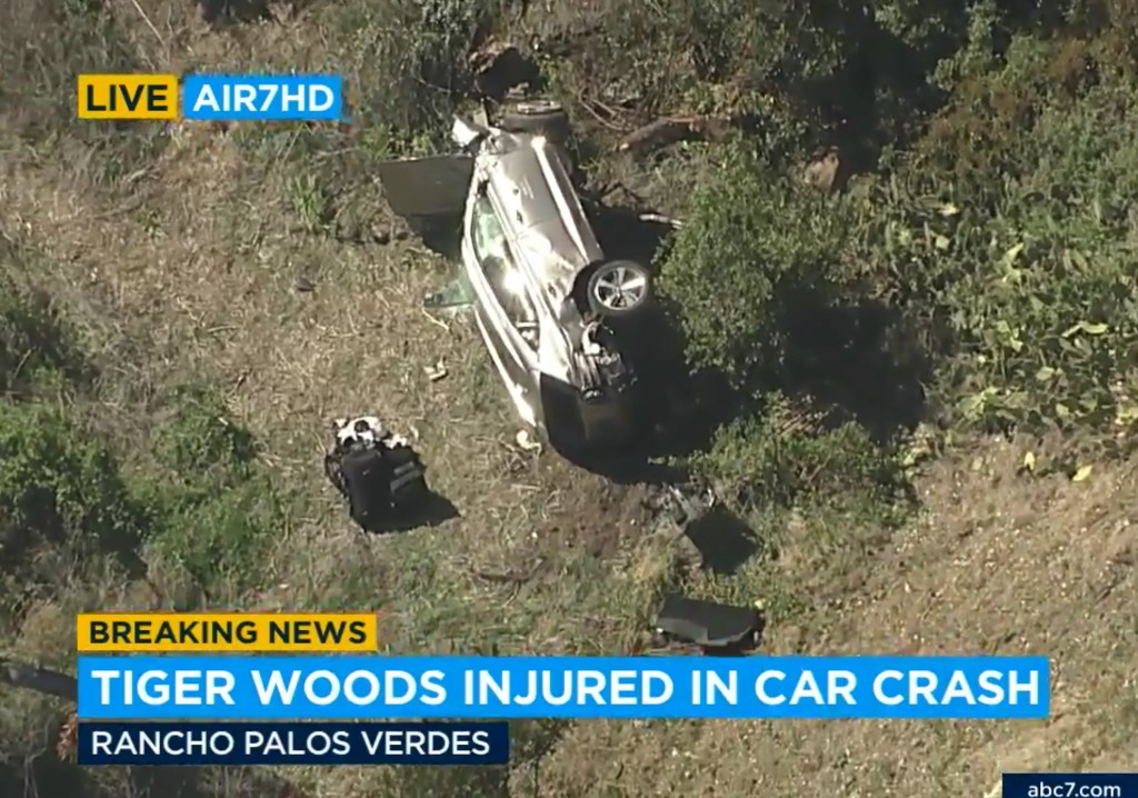 In this aerial image take from video provided by KABC-TV video, a vehicle rest on its side after a rollover accident involving golfer Tiger Woods alon...