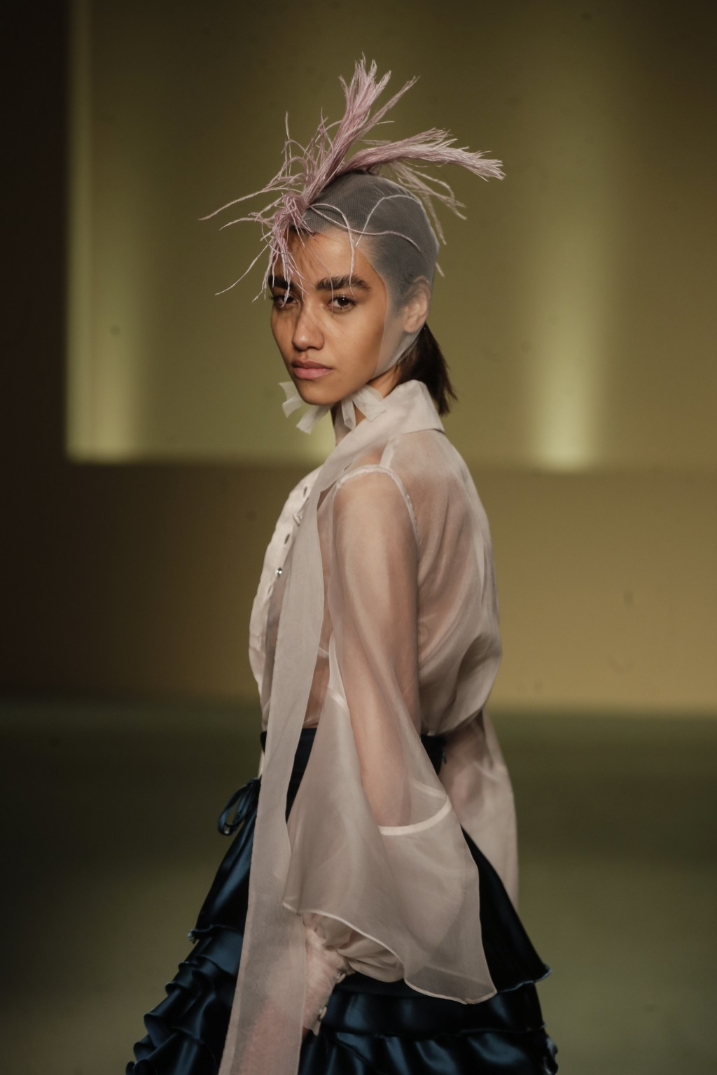 A model wears a creation by fashion designer Joy Meribe as part of the Black Lives Matter Fall/Winter 2021/22 collective fashion show, presented in Mi...