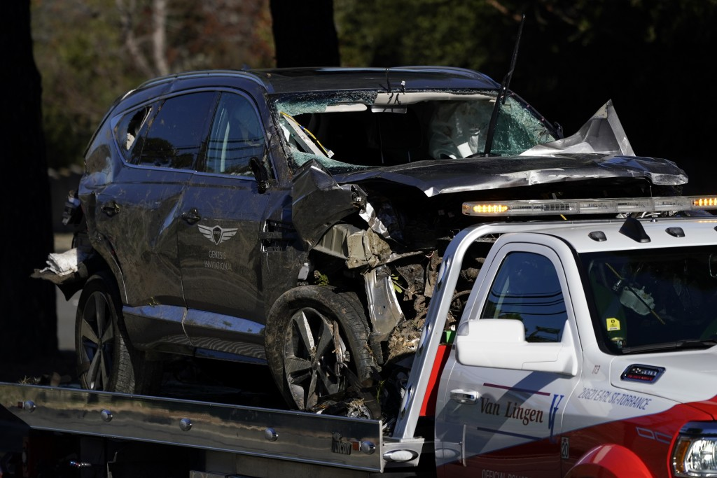 A vehicle is towed away from the site of a crash involving golfer Tiger Woods, Tuesday, Feb. 23, 2021, in the Rancho Palos Verdes suburb of Los Angele...