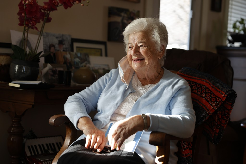 FILE - In this Nov. 12, 2020 file photo, Marjan Martin Curtis poses at her home in Spanish Fork, Utah. The 79-year-old widow, who has Stage 4 cancer, ...