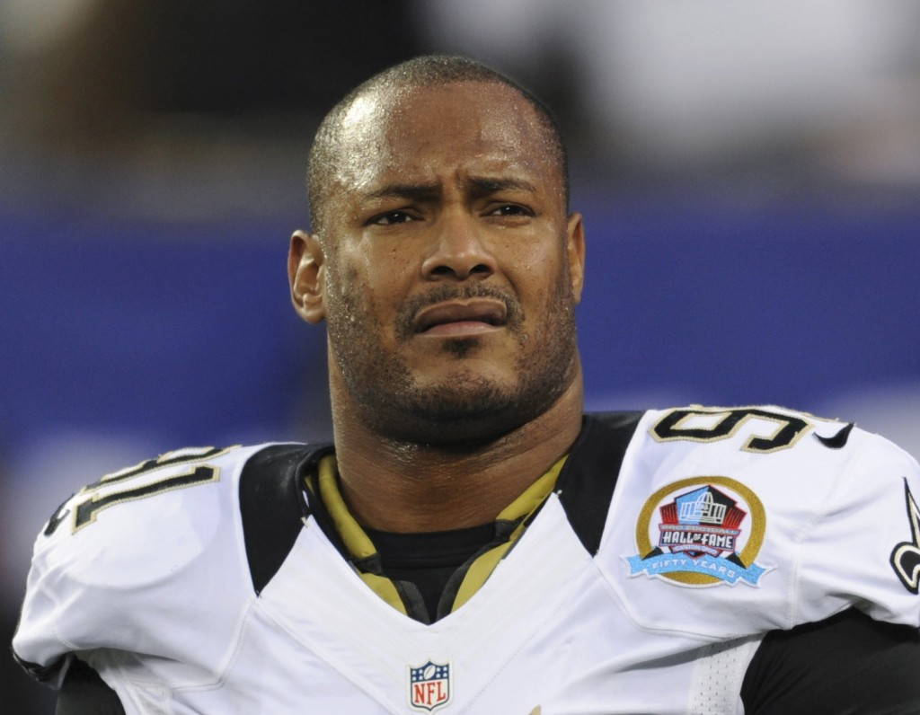 FILE - In this Dec. 9, 2012, file photo, New Orleans Saints defensive end Will Smith appears before an NFL football game against the New York Giants i...