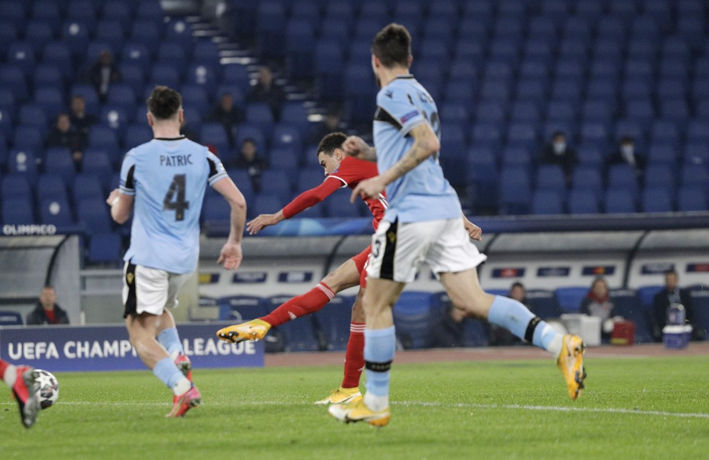 Bayern's Jamal Musiala, center, scores his side's second goal during the Champions League round of 16 first leg soccer match between Lazio and Bayern ...