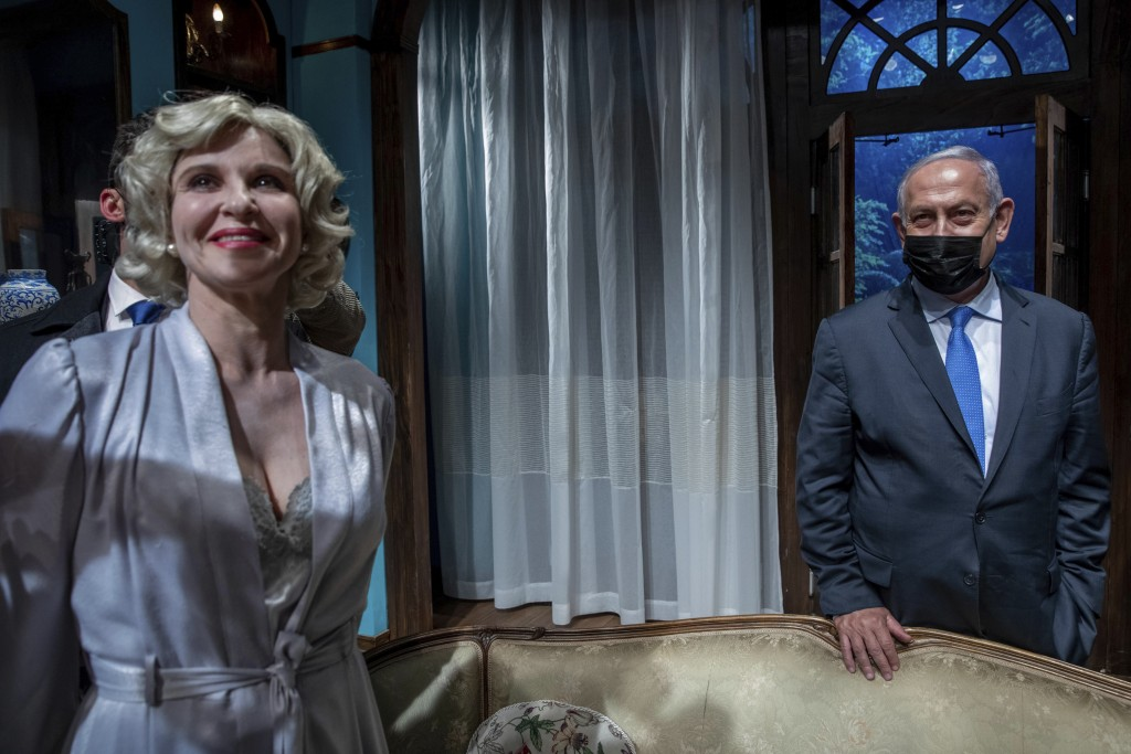 Israeli Prime Minister Benjamin Netanyahu meets Israeli actress Carmit Mesilati Kaplan, right, during a visit to the Khan theater ahead of the re-open...