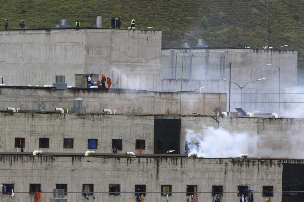 Tear gas rises from parts of Turi jail where an inmate riot broke out in Cuenca, Ecuador, Tuesday, Feb. 23, 2021. Deadly riots broke out in prisons in...