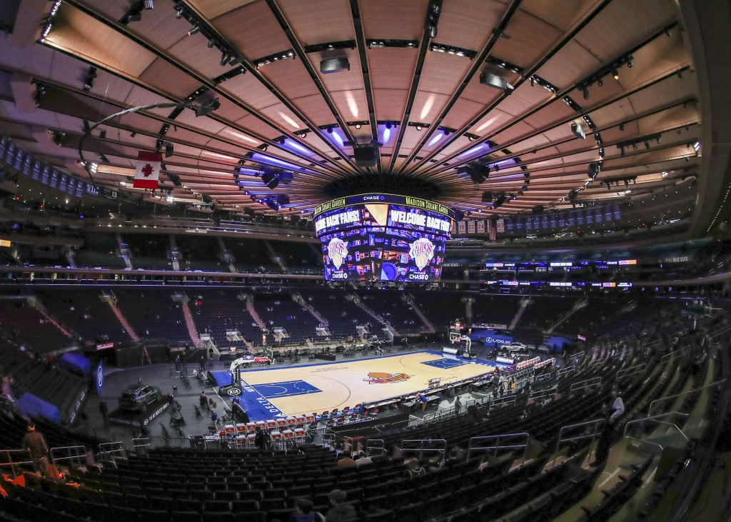 Fans arrive for an NBA basketball game between the Golden State Warriors and the New York Knicks on Tuesday, Feb. 23, 2021, in New York. A limited num...