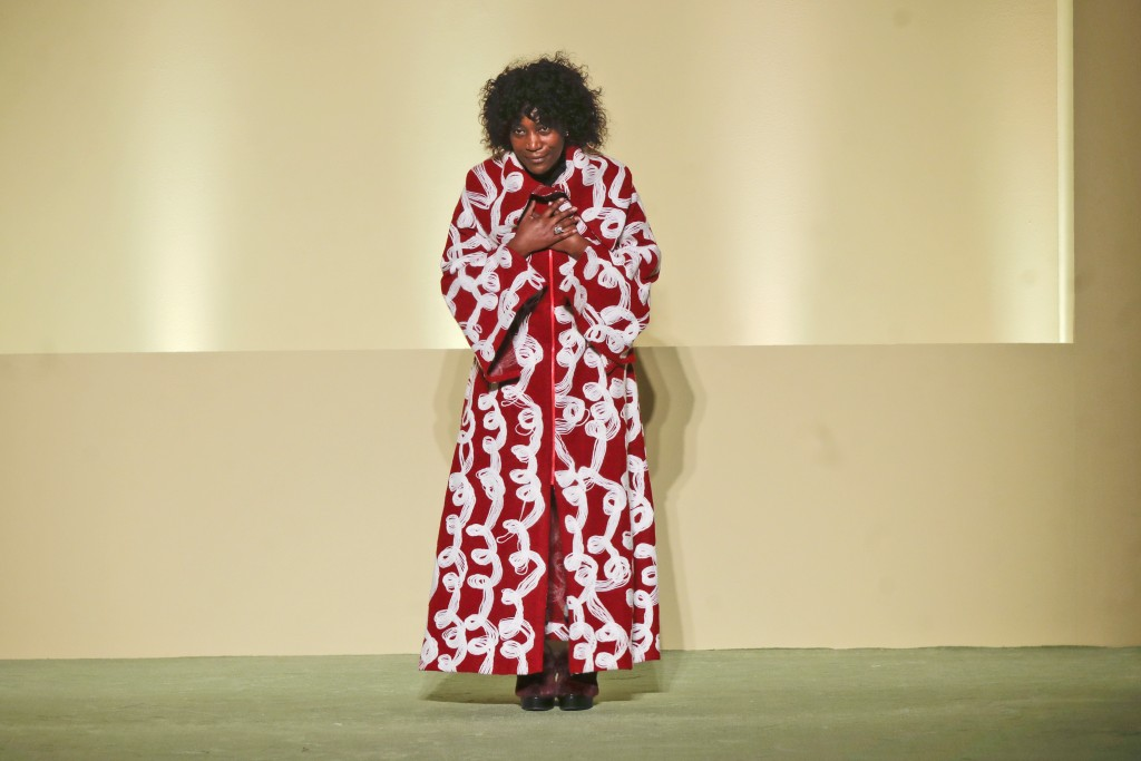 Fashion designer Fabiola Manirakiza stands on the catwalk at the end of the Black Lives Matter Fall/Winter 2021/22 collective fashion show, presented ...