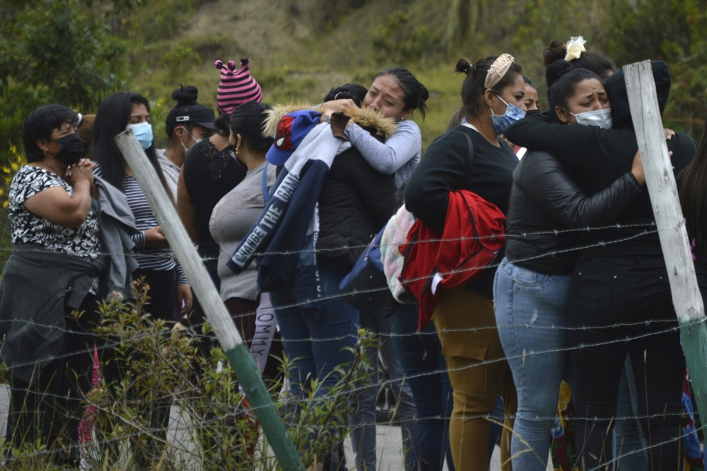 Prisoners' relatives gather outside Turi jail where an inmate riot broke out in Cuenca, Ecuador, Tuesday, Feb. 23, 2021. Deadly riots broke out in pri...