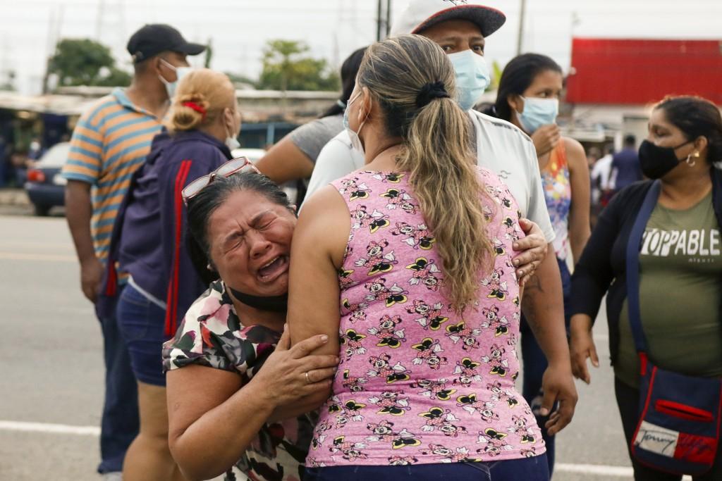 Relatives of inmates cry outside the Centro de Privación de Libertad Zona 8 prison where riots broke out in Guayaquil, Ecuador, Tuesday, Feb. 23, 2021...