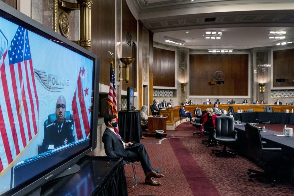 Washington Metropolitan Police Department Acting Chief of Police Robert Contee III, left, testifies via teleconference before a Senate Homeland Securi...