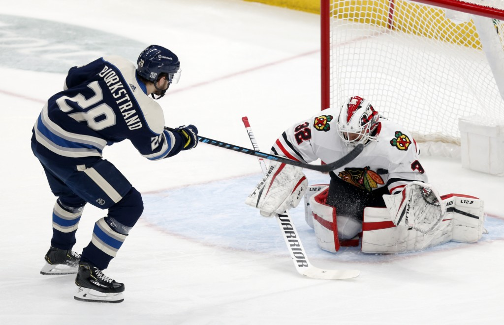 Chicago Blackhawks goalie Kevin Lankinen, right, stops a penalty shot by Columbus Blue Jackets forward Oliver Bjorkstrand during the second period of ...