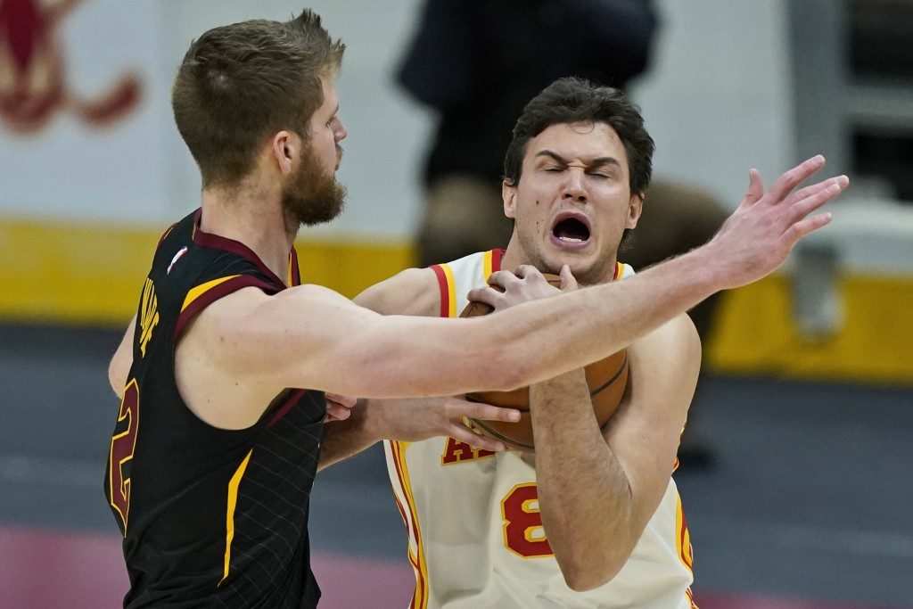 Atlanta Hawks' Danilo Gallinari, right, drives against Cleveland Cavaliers' Dean Wade in the second half of an NBA basketball game, Tuesday, Feb. 23, ...