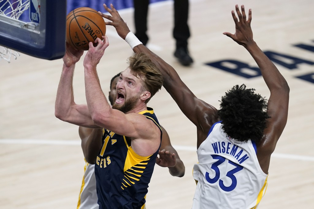 Indiana Pacers' Domantas Sabonis (11) shoots next to Golden State Warriors' James Wiseman (33) during the first half of an NBA basketball game Wednesd...