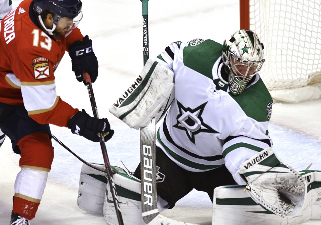 Dallas Stars goaltender Anton Khudobin (35) makes a save as Florida Panthers left wing Vinnie Hinostroza (13) closes in during the second period of an...
