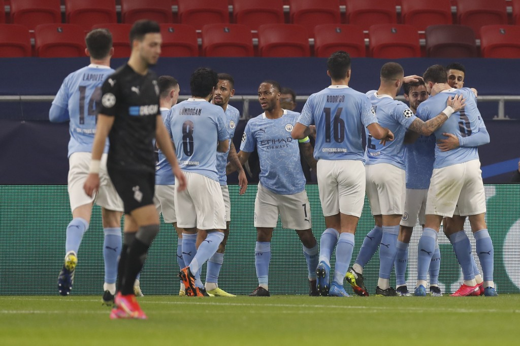 Manchester City players celebrate after Bernardo Silva scored his side's opening goal during the Champions League round of 16 first leg soccer match b...