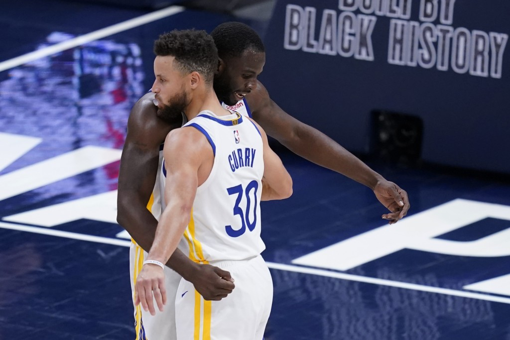 Golden State Warriors' Draymond Green and Stephen Curry embrace following the team's NBA basketball game against the Indiana Pacers, Wednesday, Feb. 2...