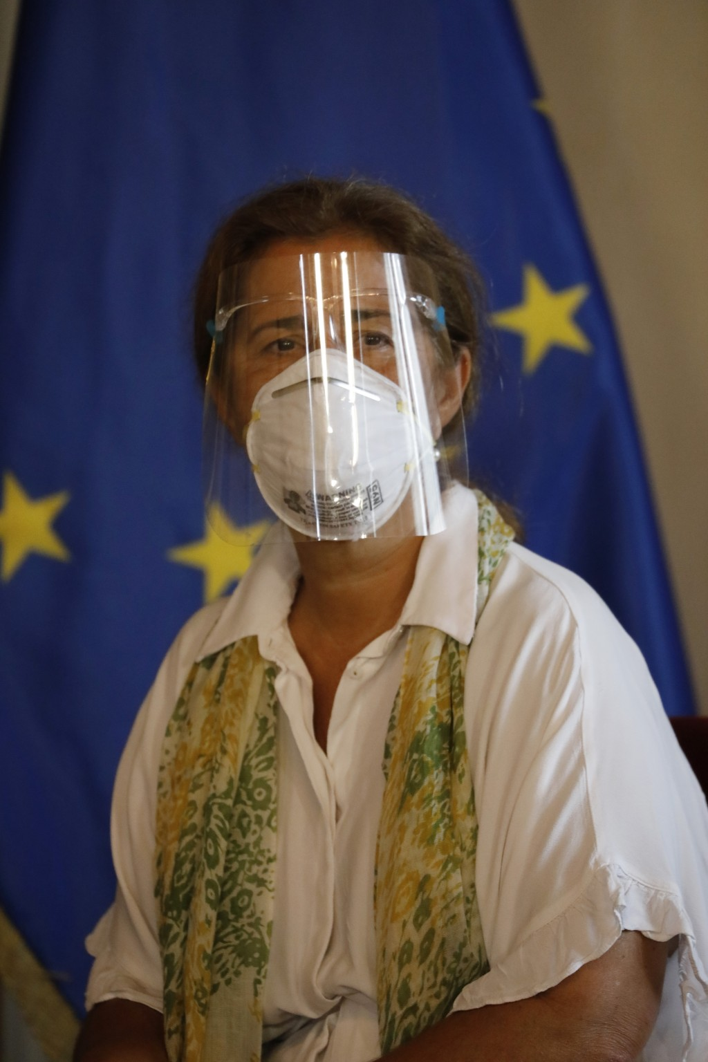 European Union Ambassador to Venezuela Isabel Brilhante Pedrosa wears a mask and face shield amid the COVID-19 pandemic, as she meets with Venezuelan ...