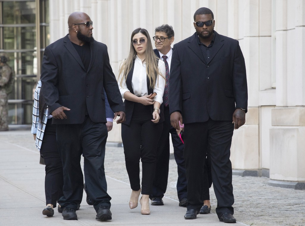 FILE- In this July 17, 2019 file photo, New York City police officer Ishmael Bailey, right, moonlights as a bodyguard for Emma Coronel Aispuro, wife o...