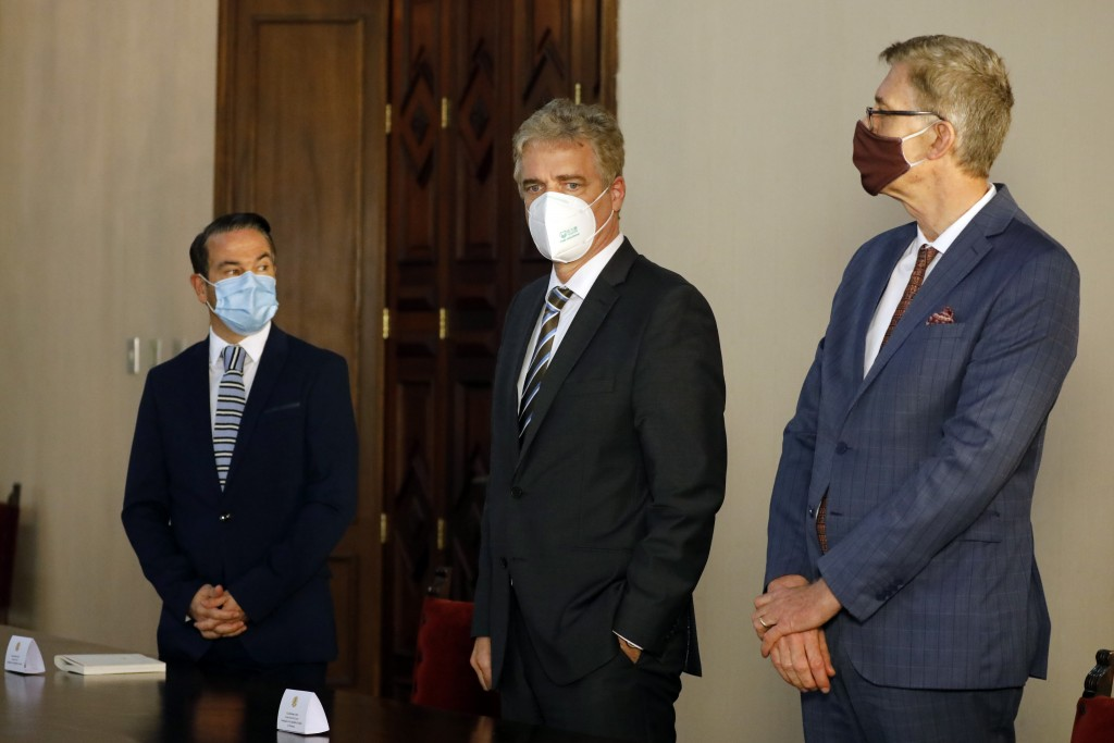 France's Ambassador to Venezuela Romain Nadal, left, Germany's Ambassador to Venezuela Daniel Kriener, center, and Charge d'Affaires for the Netherlan...