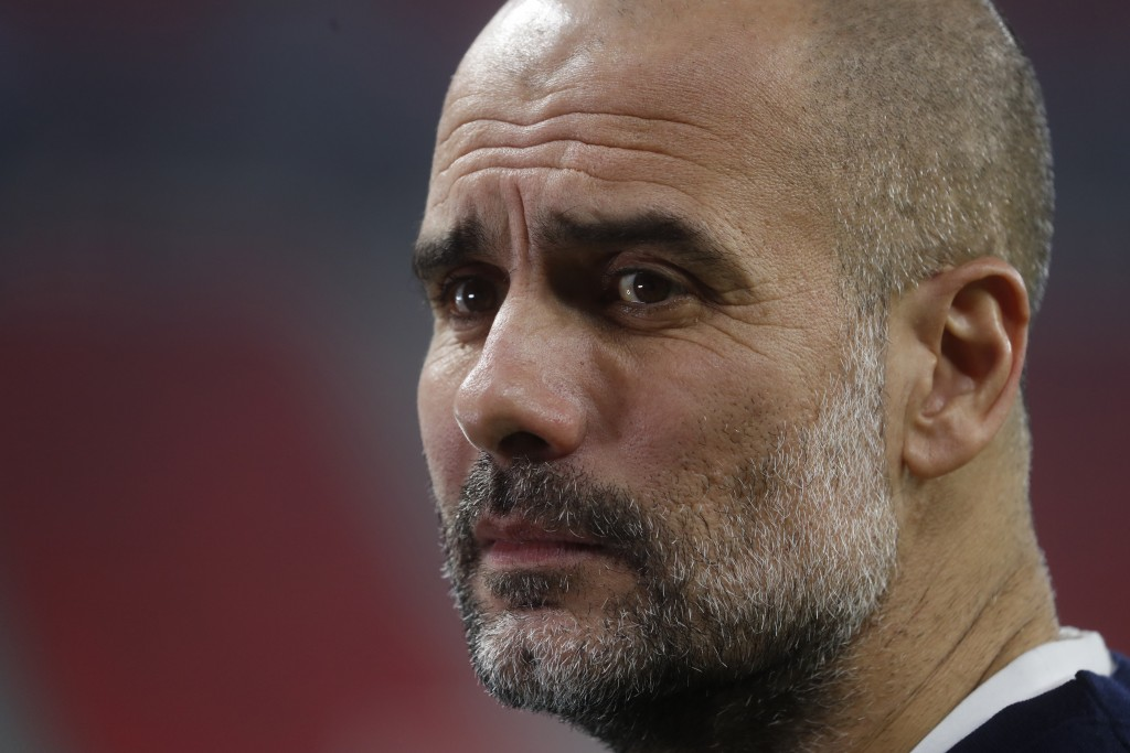 Manchester City's head coach Pep Guardiola ahead of the Champions League round of 16 first leg soccer match between Borussia Monchengladbach and Manch...