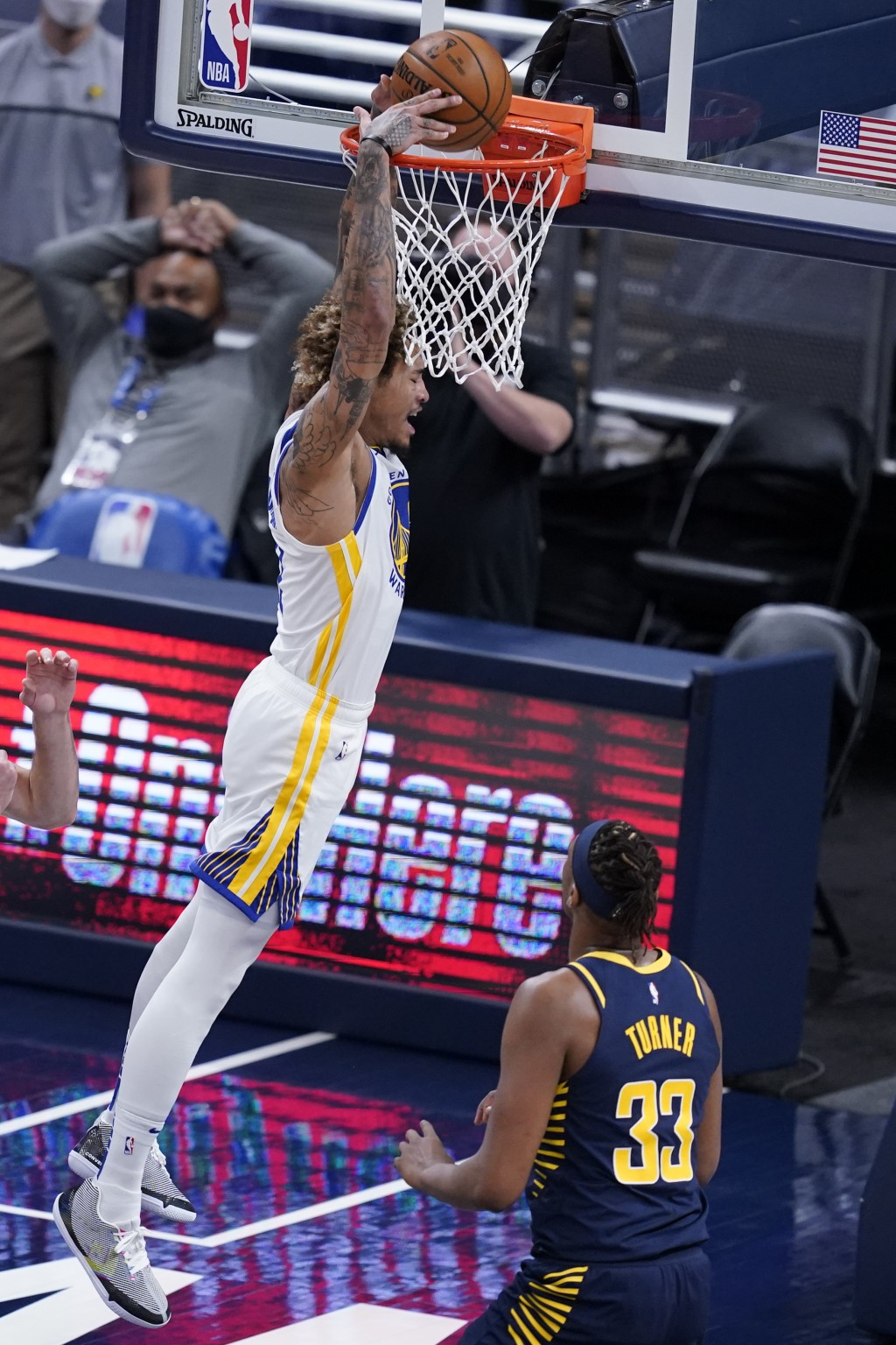 Golden State Warriors' Kelly Oubre Jr. (12) dunks next to Indiana Pacers' Myles Turner (33) during the first half of an NBA basketball game Wednesday,...