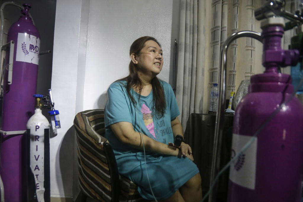 Maricar Tajo, 46, who is from the Philippines but moved to Nigeria in 2007 for work, receives oxygen from a private medical service at her house as sh...