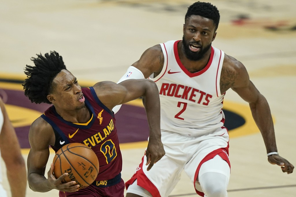 Cleveland Cavaliers' Collin Sexton, left, drives against Houston Rockets' David Nwaba in the first half of an NBA basketball game, Wednesday, Feb. 24,...