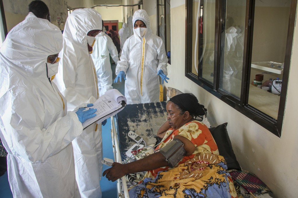 Doctors tend to a patient suffering from COVID-19 and receiving oxygen, in a ward for coronavirus patients at the Martini hospital in Mogadishu, Somal...
