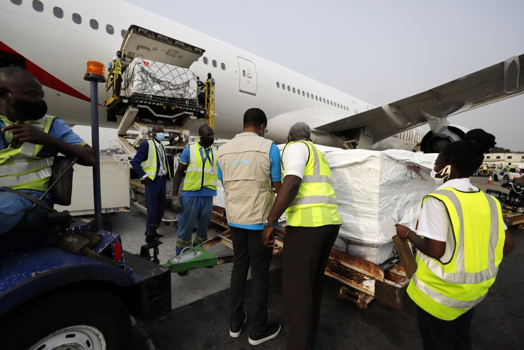 This photograph released by UNICEF Wednesday Feb. 24, 2021 shows the first shipment of COVID-19 vaccines distributed by the COVAX Facility arriving at...