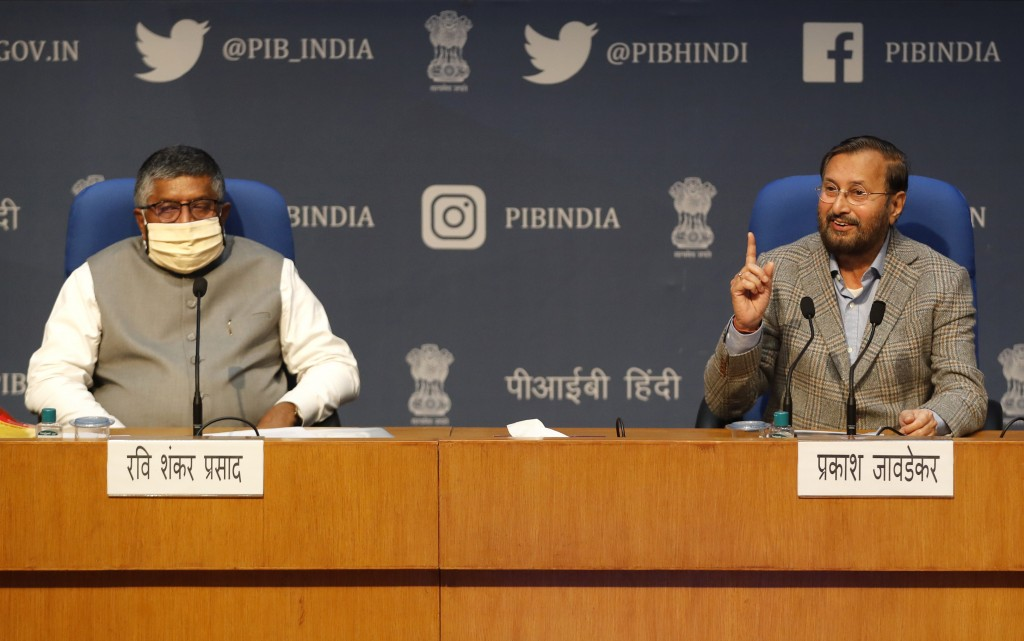 India's Information Technology Minister Ravi Shankar Prasad, left and Information and Broadcasting Minister Prakash Javadekar address a press conferen...