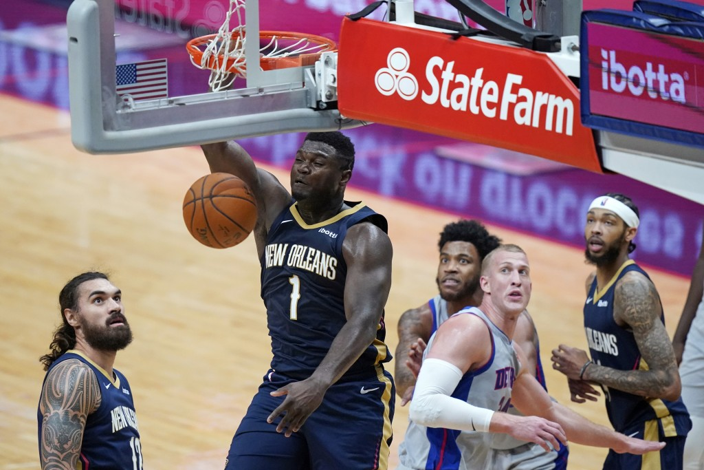 New Orleans Pelicans forward Zion Williamson (1) dunks during the second half of the team's NBA basketball game against the Detroit Pistons in New Orl...