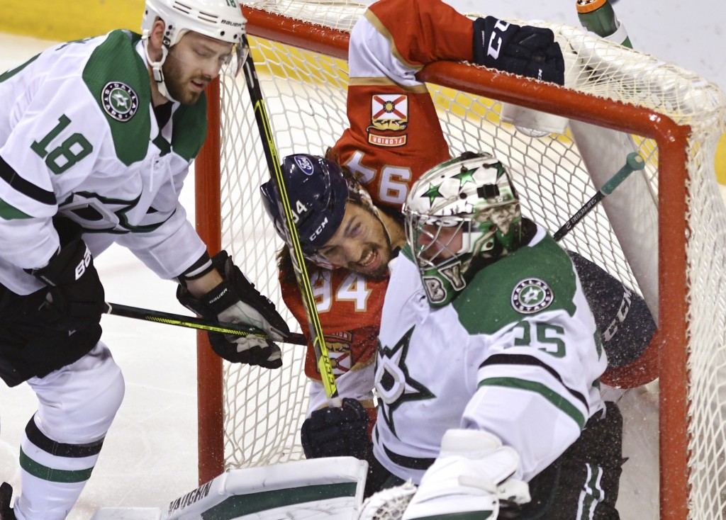 Florida Panthers left wing Ryan Lomberg (94) winds up in the net with Dallas Stars goaltender Anton Khudobin (35) as Dallas Stars center Jason Dickins...