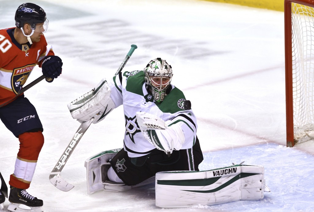 Dallas Stars goaltender Anton Khudobin (35) makes a save as Florida Panthers right wing Patric Hornqvist (70) watches during the second period of an N...