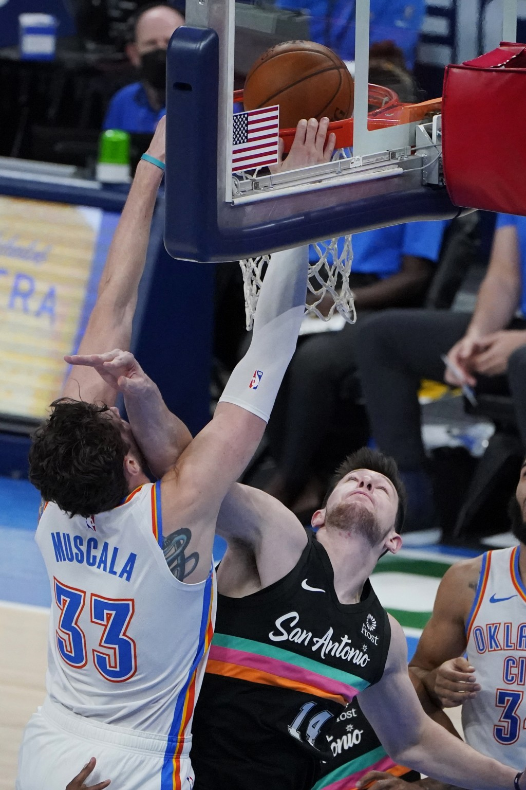 Oklahoma City Thunder center Mike Muscala (33) dunks over San Antonio Spurs forward Drew Eubanks (14) during the second half of an NBA basketball game...