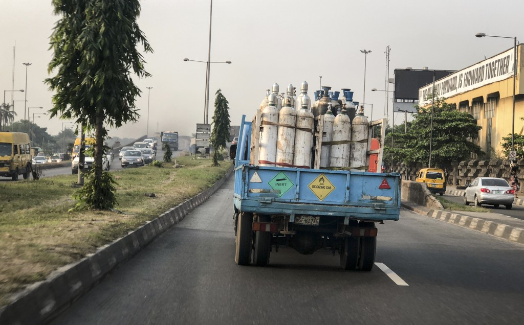 A truck transports bottles of oxygen along a street in Lagos, Nigeria Saturday, Feb. 6, 2021. A crisis over the supply of medical oxygen for coronavir...