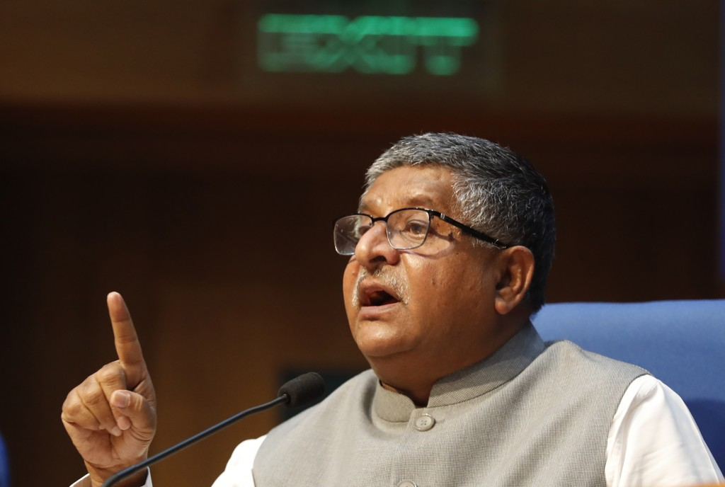 India's Information Technology Minister Ravi Shankar Prasad, addresses a press conference in New Delhi, India, Thursday, Feb. 25, 2021. India on Thurs...