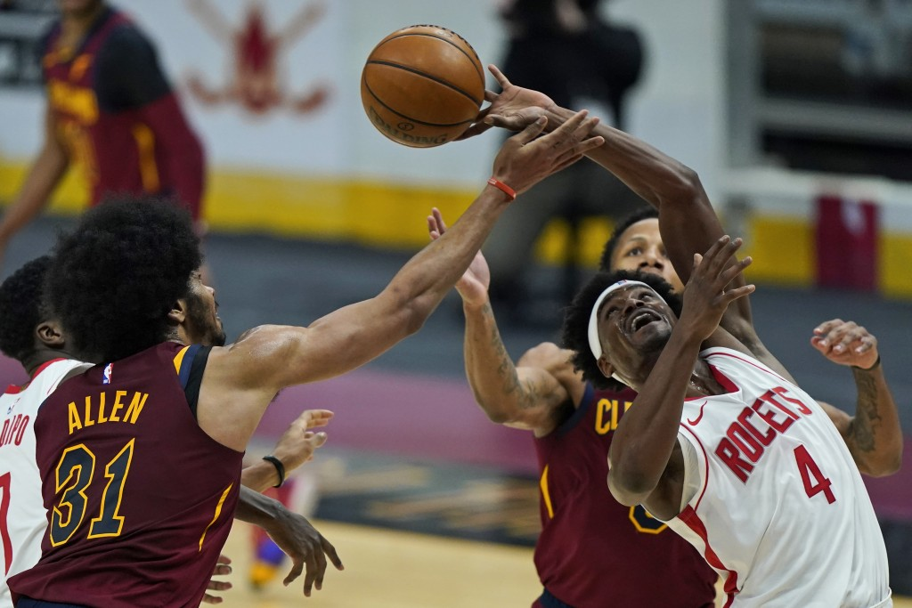 Houston Rockets' Danuel House Jr. (4) and Cleveland Cavaliers' Jarrett Allen (31) battle for a rebound in the first half of an NBA basketball game, We...