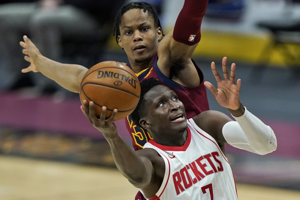 Houston Rockets' Victor Oladipo, front, drives to the basket against Cleveland Cavaliers' Isaac Okoro in the second half of an NBA basketball game, We...