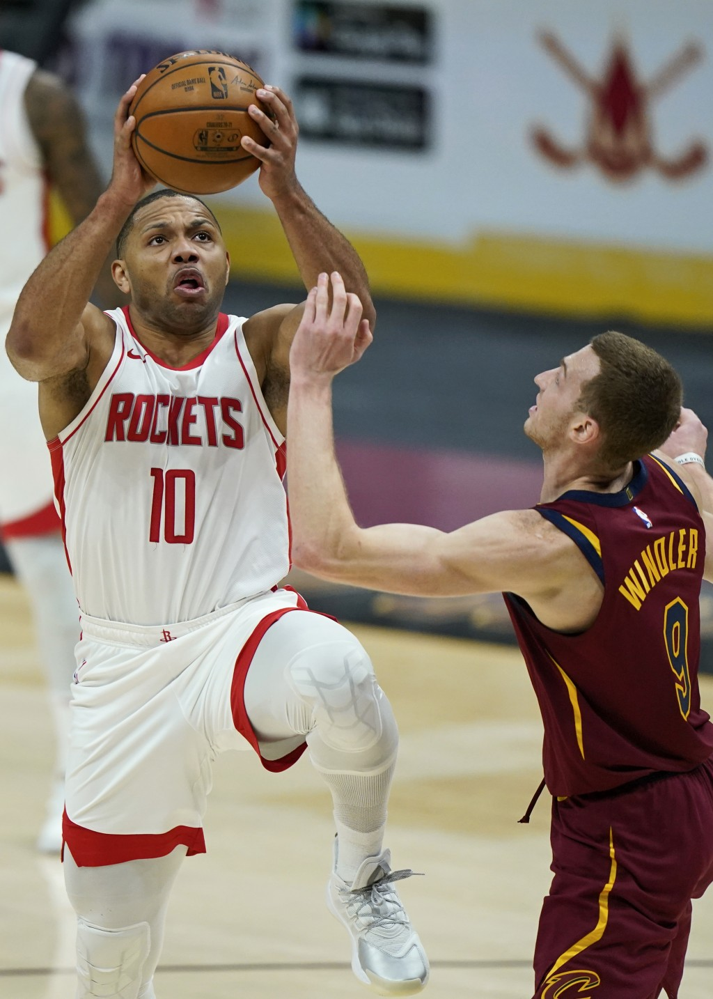 Houston Rockets' Eric Gordon (10) drives to the basket against Cleveland Cavaliers' Dylan Windler (9) in the second half of an NBA basketball game, We...