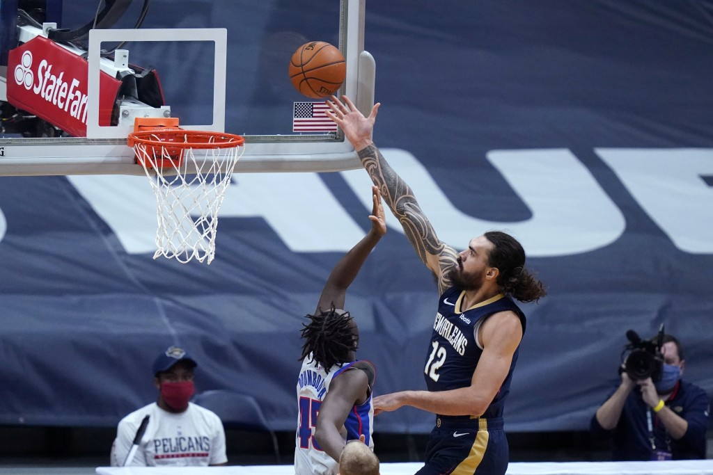 New Orleans Pelicans center Steven Adams (12) goes to the basket against Detroit Pistons forward Sekou Doumbouya (45) during the first half of an NBA ...