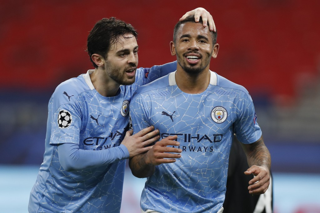 Manchester City's Gabriel Jesus, right, celebrates with Manchester City's Bernardo Silva after scoring his side's second goal during the Champions Lea...