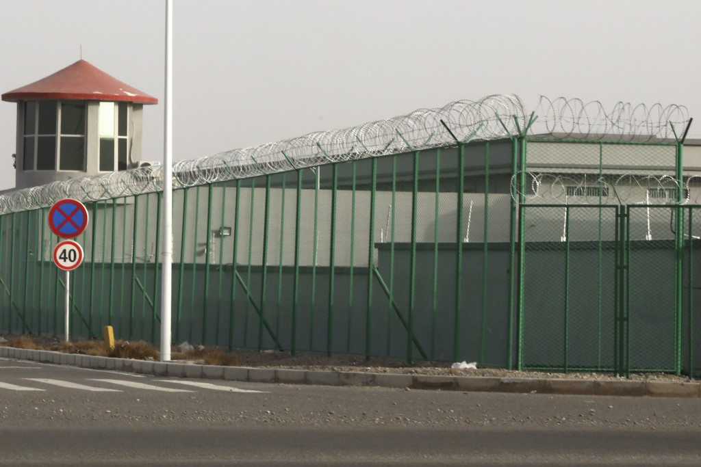 FILE - In this Monday, Dec. 3, 2018, file photo, a guard tower and barbed wire fence surround a detention facility in the Kunshan Industrial Park in A...