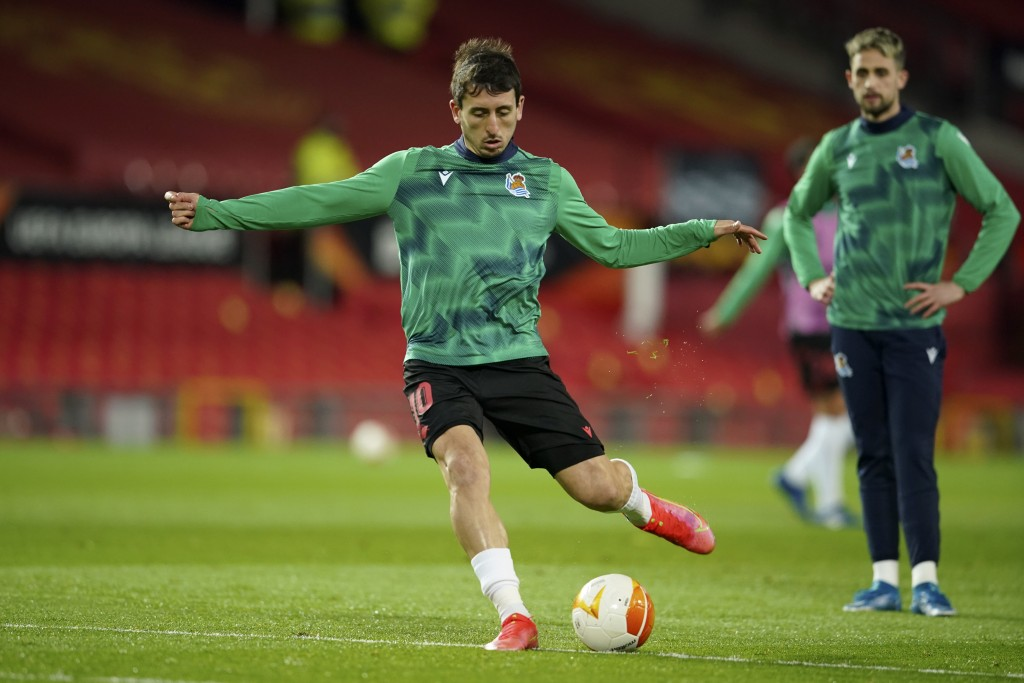 Real Sociedad's Mikel Oyarzabal kicks a ball during warmup before the Europa League round of 32, second leg, soccer match between Manchester United an...