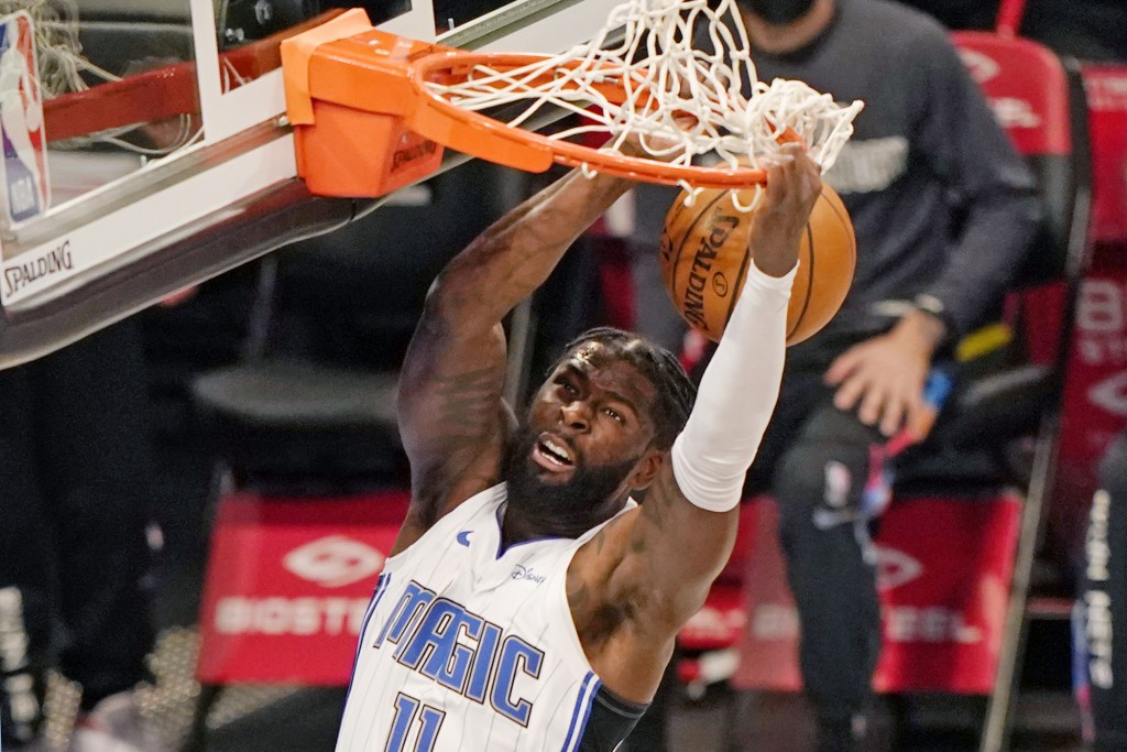 Orlando Magic forward James Ennis III (11) dunks unopposed during the first quarter of an NBA basketball game against the Brooklyn Nets, Thursday, Feb...