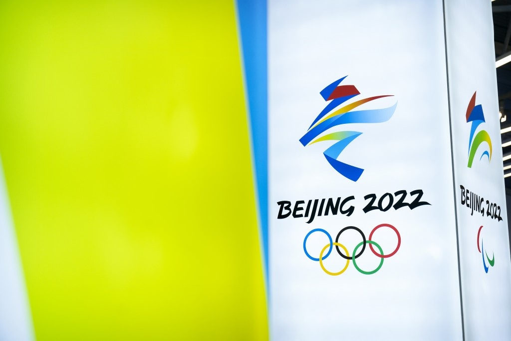 The logos for the 2022 Beijing Winter Olympics and Paralympics are seen at an exhibit at a visitors center at the Winter Olympic venues in Yanqing on ...