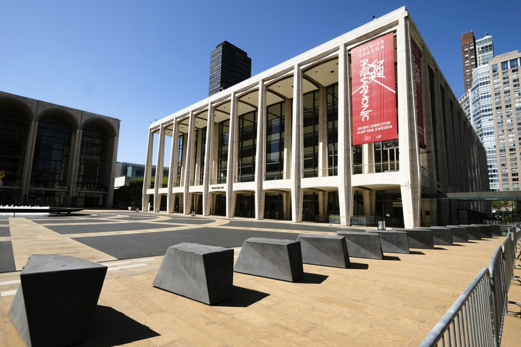FILE - This May 12, 2020 file photo shows David Geffen Hall at Lincoln Center, closed during COVID-19 lockdown, in New York.  Lincoln Center intends t...