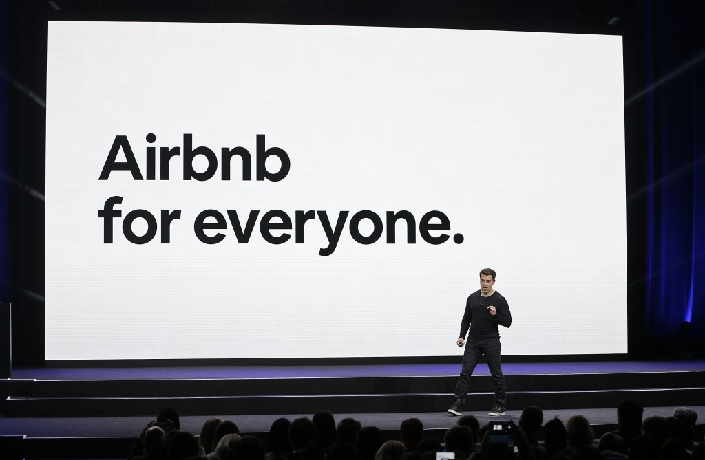 FILE - In this Feb. 22, 2018, file photo, Airbnb co-founder and CEO Brian Chesky speaks during an event in San Francisco. Activists and lawyers are ta...
