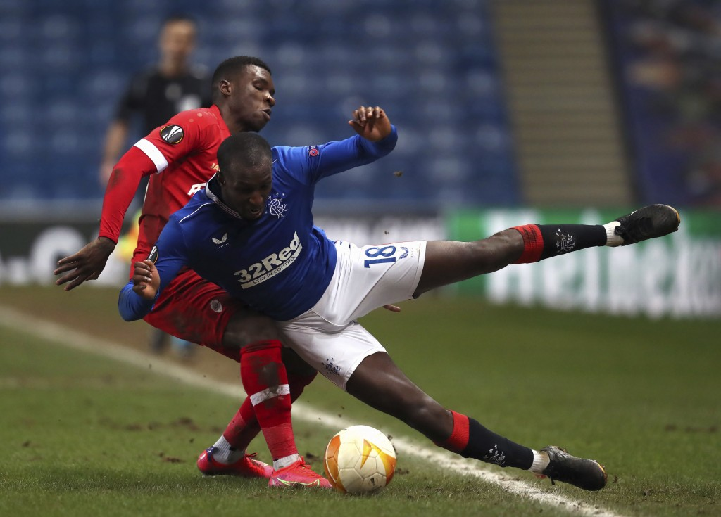 Royal Antwerp's Buta collides with Rangers' Glen Kamara, right, during their Europa League soccer match at the Ibrox Stadium in Glasgow, Scotland, Thu...