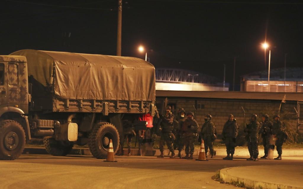 "Soldiers leave the prison ""Centro de Rehabilitacion Social Regional Centro Norte Cotopaxi"" where deadly riots broke out inside, two days prior in Lata..."