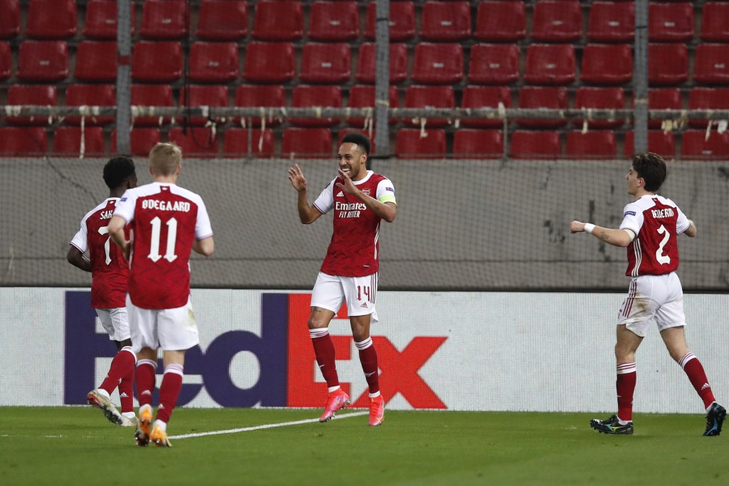 Arsenal's Pierre-Emerick Aubameyang, second right, celebrates with teammates after scoring the opening goal during the Europa League second leg soccer...