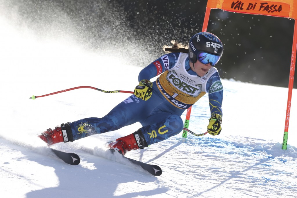 United States' Breezy Johnson speeds down the slope during an alpine ski, women's World Cup downhill, in Val di Fassa, Italy, Friday, Feb. 26, 2021. (...